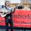 John Butler performs a 'rebel busk' outside the head offices of two of Australia's biggest gas and petroleum companies. Perth, Western Australia, 30 May 2011. Photographer Talhy Stotzer.