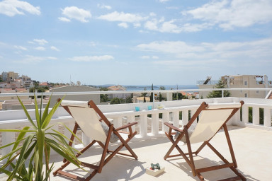 Relax and enjoy the view from the large private roof terrace
