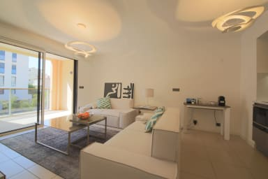 Contemporary apartment located in a residence with pool near Palm Beach.
