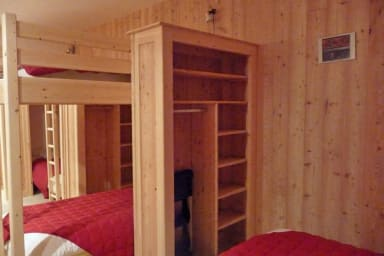 bedroom with bunks beds ans simple beds