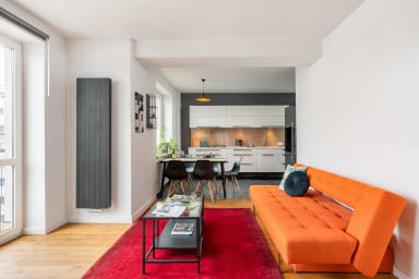 The open, bright space consists of three parts - living room, kitchen and...