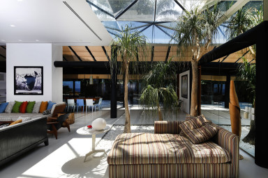 Comfy space with  transparent ceiling in a luxury villa with a view