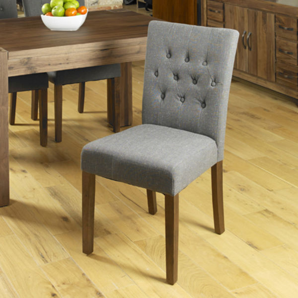 Two grey linen dining chairs