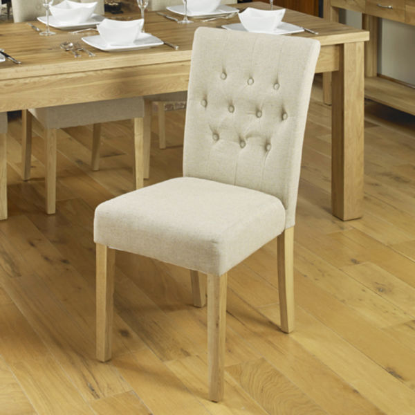 Two cream flock chairs