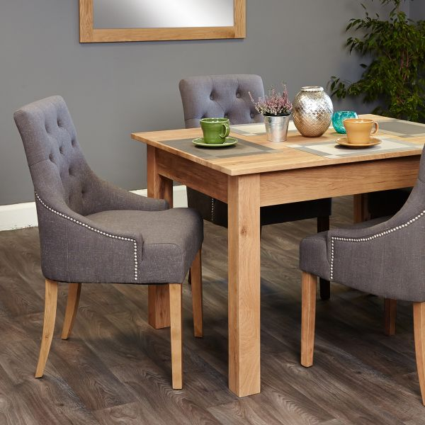 Mobel Oak four seat table and grey chairs with arms