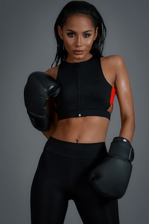 CHARLOTTE CROSBY BLACK AND RED ZIP FRONT CUT OUT SPORTS BRA