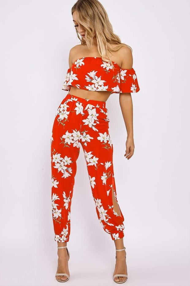 LIORIA RED FLORAL BARDOT TOP AND SPLIT SIDE TROUSER CO ORD