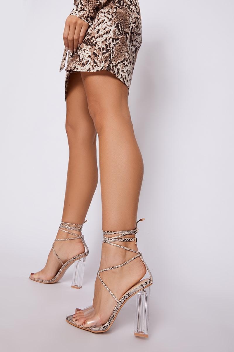 20de3fcfbc0 Liane Nude Snake Print Clear Strap Heels