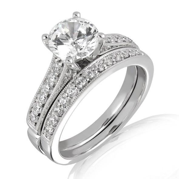แหวนทอง 18K ประดับเพชร น้ำหนักรวม 1.35 กะรัต ค่าสี F ค่าความสะอาด VVS2 EX/EX/EX เพชรมาพร้อมใบรับรองจากสถาบัน GIA และแหวนเพชร Matching Band