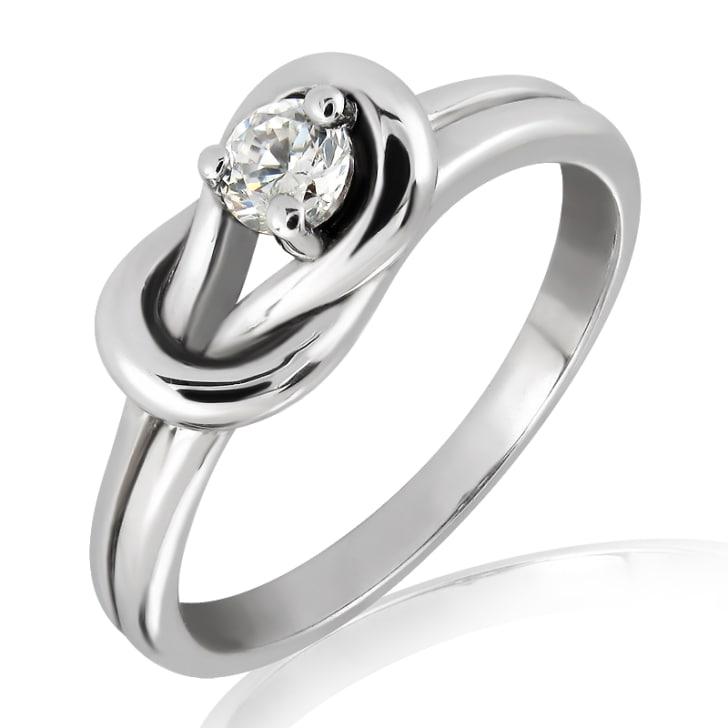 แหวนทอง 18K ประดับเพชร น้ำหนักรวม 0.15 กะรัต ค่าสี F ค่าความสะอาด VS