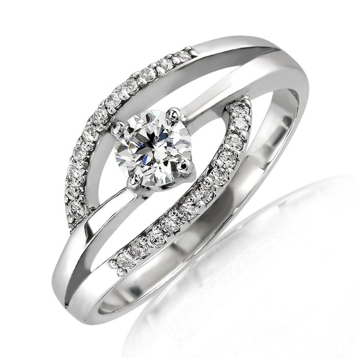 แหวนทอง 18K ประดับเพชร น้ำหนักรวม 0.50 กะรัต ค่าสี G ค่าความสะอาด VS2 EX/EX/EX เพชรมาพร้อมกับใบรับรองจากสถาบัน GIA
