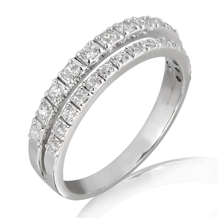 แหวนทอง 18K ประดับเพชร น้ำหนักรวม 0.25 กะรัต ค่าสี E ค่าความสะอาด VS1