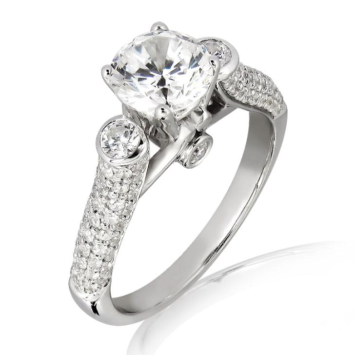 แหวนทอง 18K ประดับเพชร น้ำหนักรวม 1.12 กะรัต ค่าสี F ค่าความสะอาด VS2
