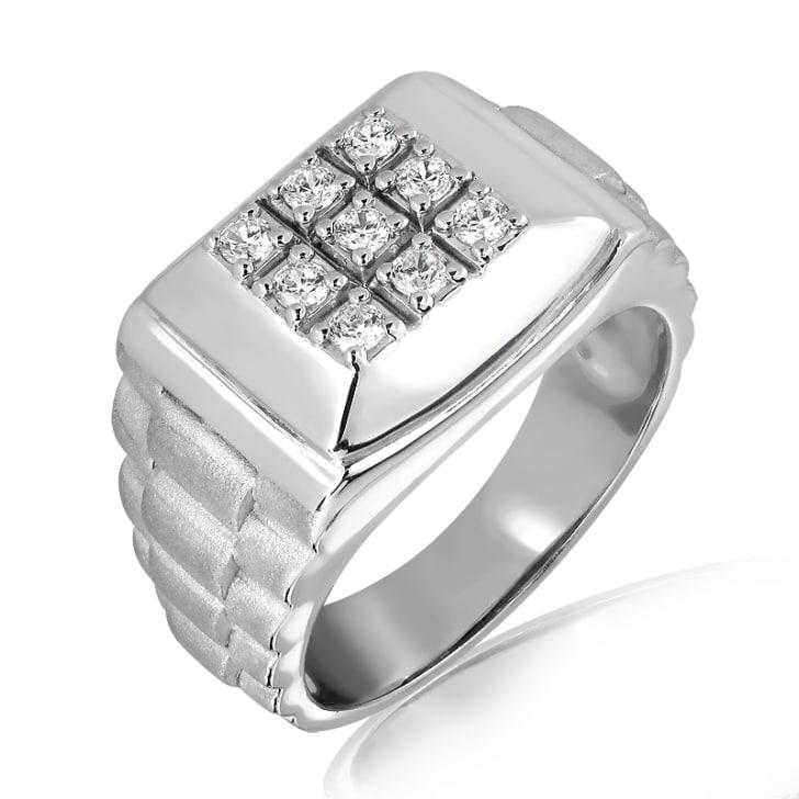 แหวนทอง 18K ประดับเพชร น้ำหนักรวม 0.23 กะรัต ค่าสี E ค่าความสะอาด VS2