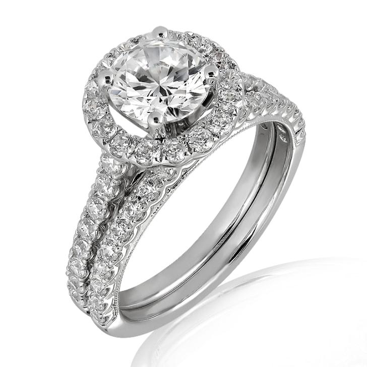 แหวนทอง 18K ประดับเพชร น้ำหนักรวม 1.50 กะรัต ค่าสี D ค่าความสะอาด VVS2 EX/EX/EX เพชรมาพร้อมใบรับรองจากสถาบัน GIA และแหวนเพชร Matching Band