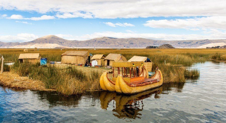 Floating Islands on Lake Titicaca Puno, Peru, South America, thatched home