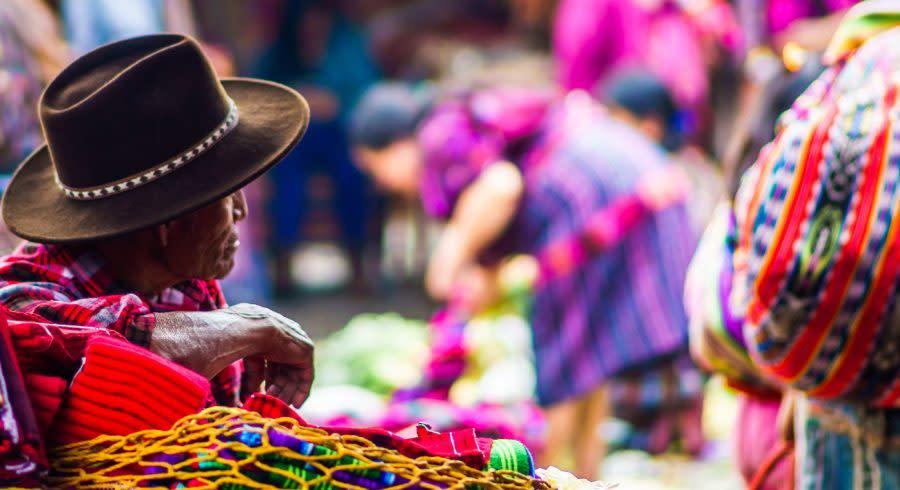 Enchanting Travels Guatemala Tours View on old maya man on market in Chichicastenango
