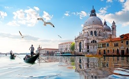 Enchanting Travels Italy Tours Seagulls and old cathedral of Santa Maria della Salute in Venice, Italy