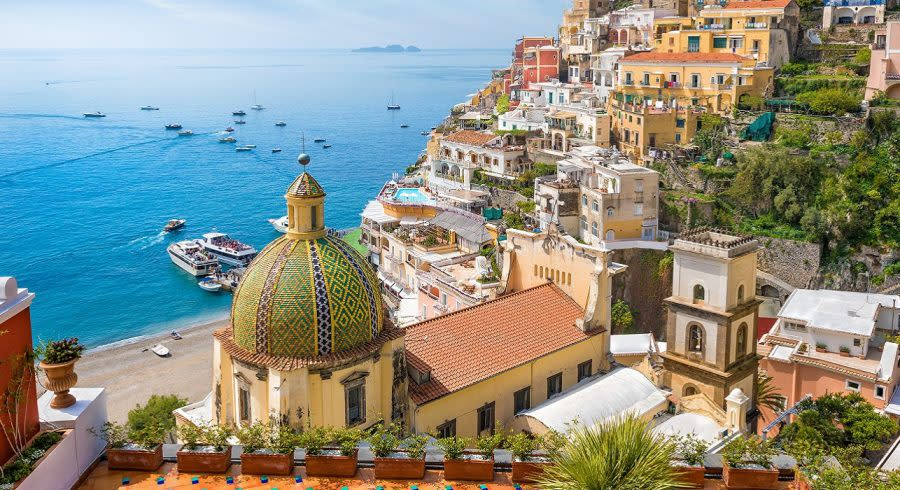 Enchanting Travels Italy Tours Beautiful Positano on hills leading down to coast - top 10 relaxing holiday destinations in europe