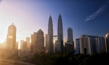 a view of Petronas Towers with tall buildings