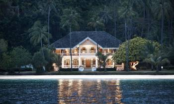 a house next to a body of water