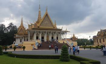 a statue in front of Royal Palace, Phnom Penh