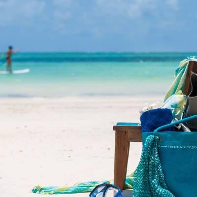 a person sitting at a beach