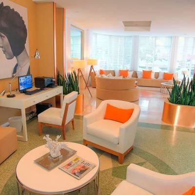 an orange room with a couch and a table