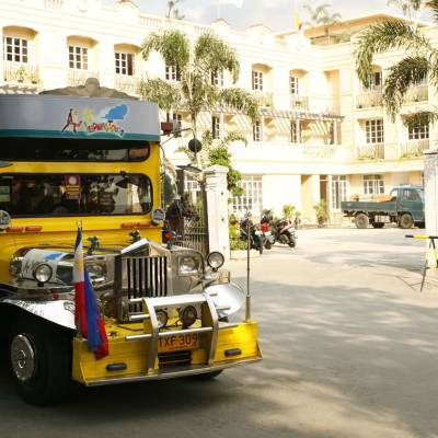 a yellow bus driving down a city street