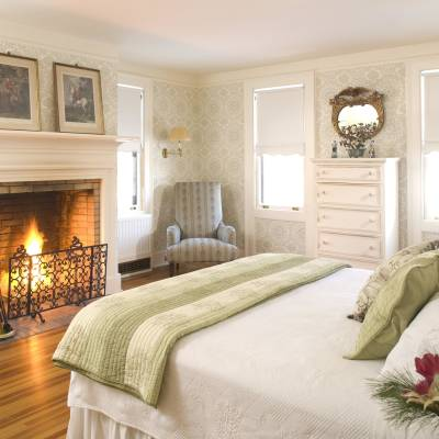 a bedroom with a bed and a fireplace