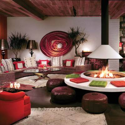 a living room filled with furniture and a red table