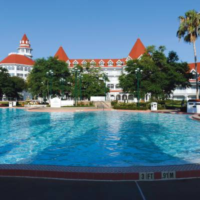 a large pool of water with Disney's Grand Floridian Resort & Spa in the background