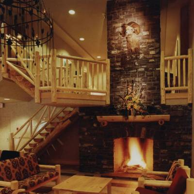 a room filled with furniture and a fireplace