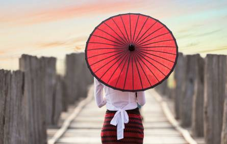 a person holding a colorful umbrella