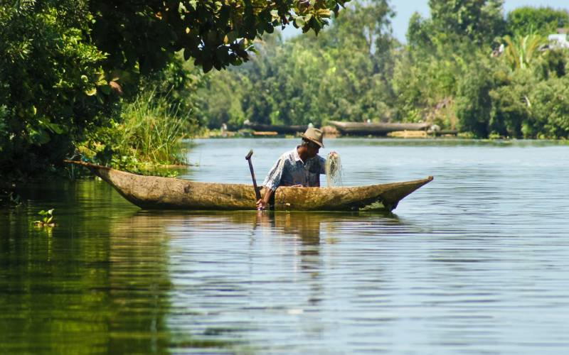 a man rowing a boat in a body of water
