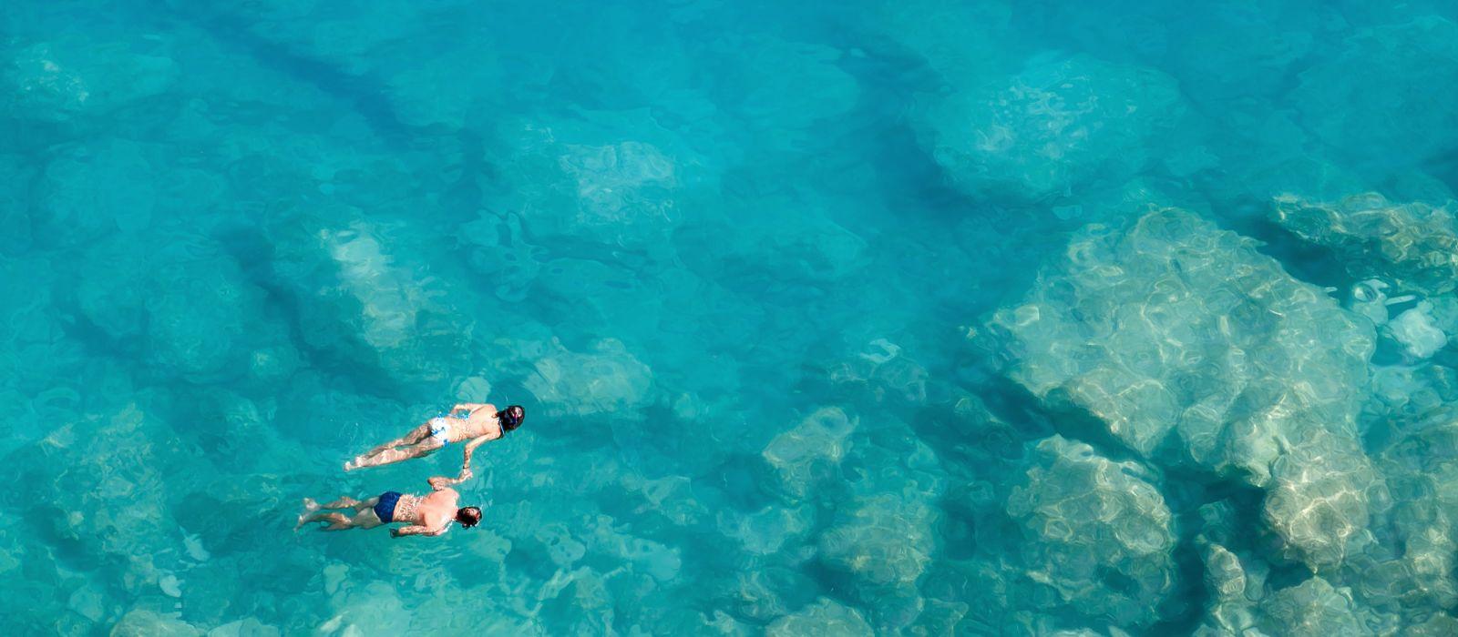 Couple snorkeling, Maldives, Asia - history of Maldives