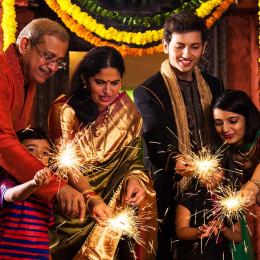 Enchanting Travels India Tours Indian Family celebrating Diwali festival with fire crackers