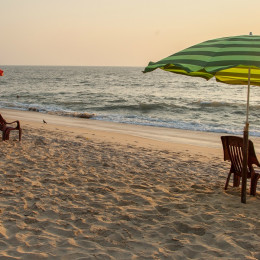 Enchanting Travels India ToursChairs and umbrella at Marari Beach, Kerala. It is one of the most popular beaches in Kerala