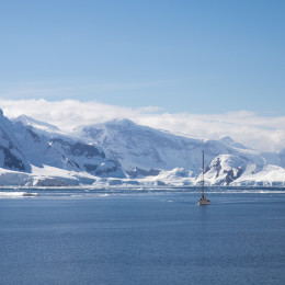 A sailing ship sails through the neumayer channel, Antarctica