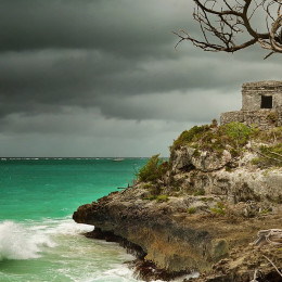 Enchanting Travels Mexico Tours Panoramic view of the old Watchtower in the ancient city of Tulum on the Caribbean coast before it rains, Mexico