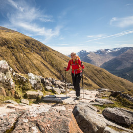 Enchanting Travels UK & Ireland Tours Pretty, young female hiker going uphill