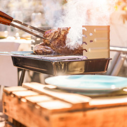 Enchanting Travels Australia Tours grill t-bone steak at barbecue dinner outdoor