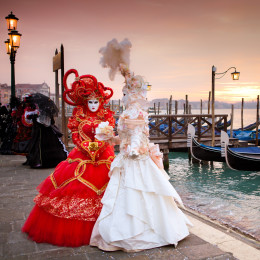Enchanting Travels Italy tours Sunrise in Venice Italy in front of Gondolas on the Grand Canal Beautiful costumed women