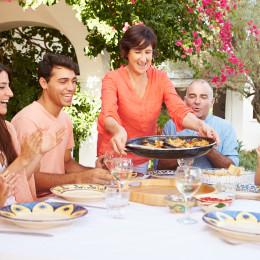 Family enjoying Spanish cuisine together