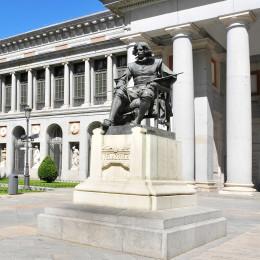 Things to do in spain - monument to Velazquez in Paseo del Prado, in front of the Puerta de Velazquez entrance to the Museo del Prado in Madrid, Spain