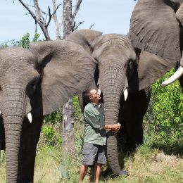 Enchanting Travels-Botswana Tours-Okavango Delta-Sanctuary Stanley's Camp-Doug hugging Tembi Marula and Jabu low