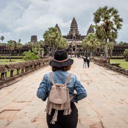 Women tourists wear jacket jeans walking into Angkor Wat landmark in Siem Reap, Cambodia, Asia