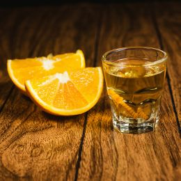 Enchanting Travels Mexico Tours Mezcal mexican drink with orange slices and worm in oaxaca mexico