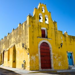 Yellow church and colonial architecture in Campeche, Mexico Tours
