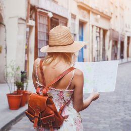 Woman tourist with map on the street, Europe